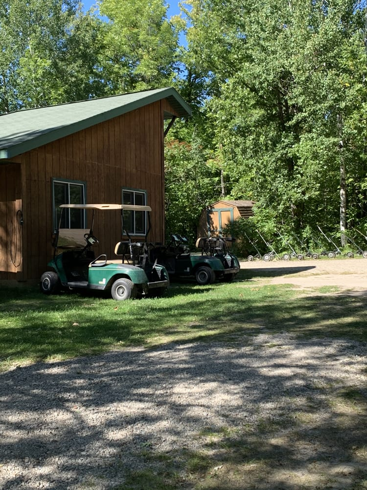 Clubhouse exterior and golf carts