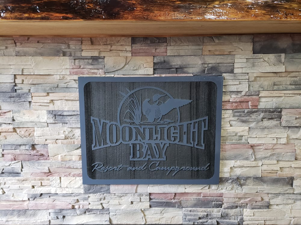 Moonlight Bay Resort and Campground wood sign.